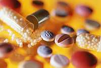 The photo shows a colourful mixture of different tablets.