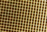 Close-up of a ceramic grid coated with catalytically active substances.